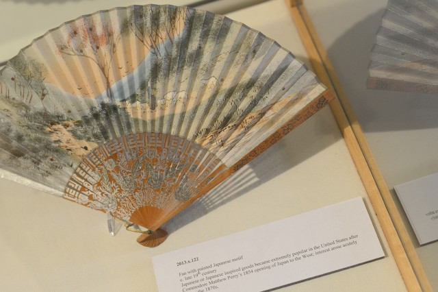 The exhibit features this fan with a painted Japanese motif from the late 19th century.  Japanese or Japanese inspired goods became extremely popular in the United States after Commodore Matthew Perry's 1854 opening of Japan to the West; interest arose acutely during the 1870s.
