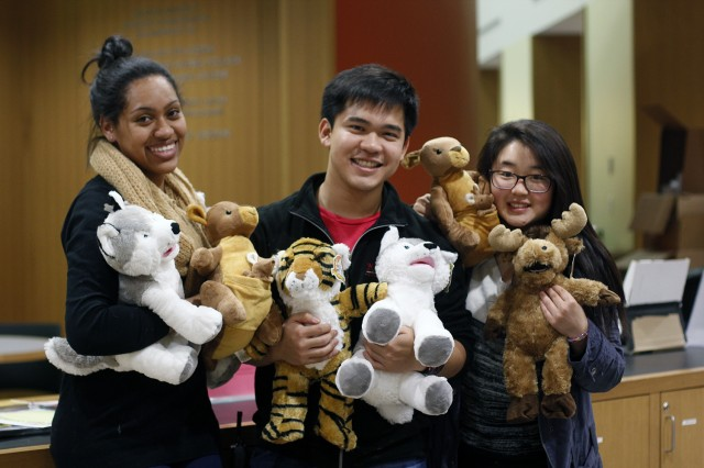 Shamira Dwarica '15, Martin Malabanan '16 and Jamie Jung '16 pose with their stuffed animals.