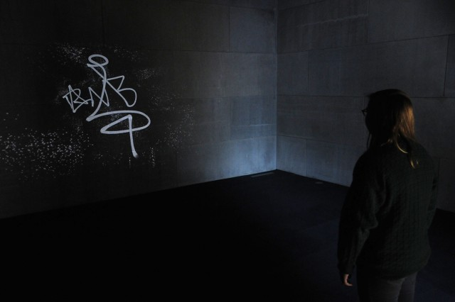 "In the video projection, ""Graffiti Analysis, 2009,"" Roth creates visualizations of the often unseen gestures involved in the creation of a tag, typically created in haste and out of the public eye. Each stream of ""paint"" calligraphically skates across the gallery's wall leaving the overspray as evidence of the energy behind the original marks."