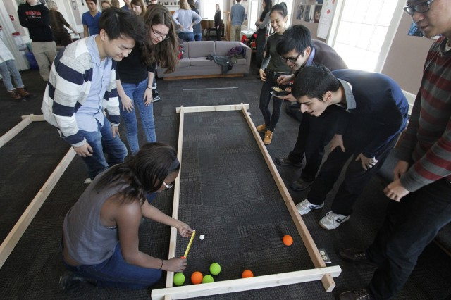 Students studying French, Spanish, Italian and Portuguese are participating in Wesleyan's first bocce ball tournament (Bocce Pétanque Bocha Petanca) hosted by Romance Languages and Literatures.