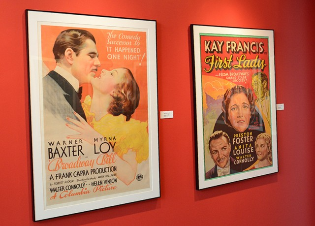 "Spanning the history of film from the 1930s to 2012, the posters in this exhibit reflect different genres and styles; the iconic artwork brings back the magic of the moviegoing experience. Pictured at left is a 1934 movie poster from Columbia Pictures' ""Broadway Bill."" The poster represents Cinema Archives' Frank Capra Collection. At right is a 1937 poster from Warner Bros.' ""First Lady,"" which represents the Kay Francis Collection."