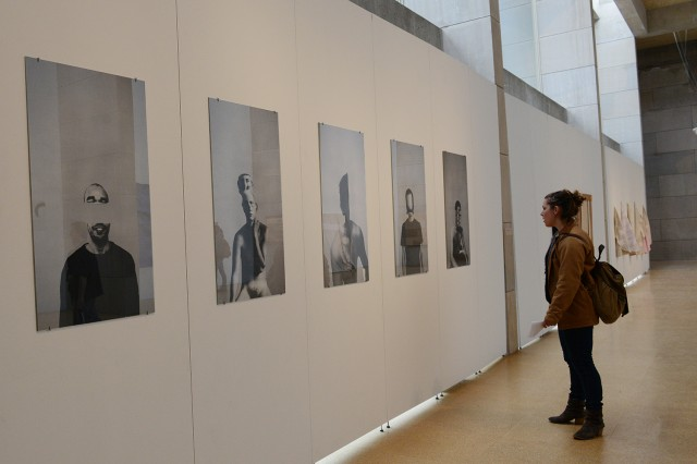 """Emily Pfoutz '16 looks at a senior art thesis created by Carlos Sanchez titled """"pilose."""""""