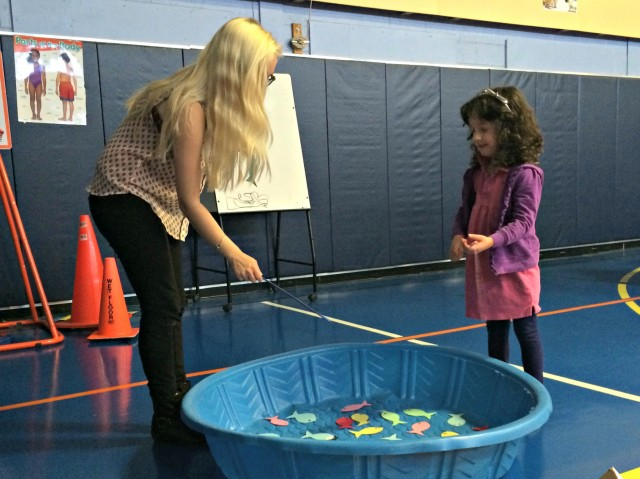 Maddy Oswald '14 goes fishing for numbers with Callie during Edna Stevens Elementary School's Family Math Night.