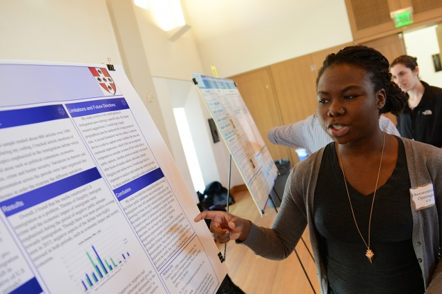 "More than 45 students presented their research or thesis research at the Psychology Research Poster Presentation April 24 in Beckham Hall. Oluwaremilekun Ojurongbe '14 presented her study, ""Illegality, Criminality and the Taxpayer's Burden: The Incomplete U.S. Immigration Narrative."" Her advisor was Sarah Carney, visiting faculty with the Psychology Department."
