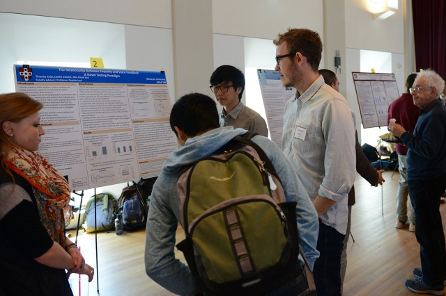"Timothy Kelly '14, Caitlin Daniels '15 and Min Cheol Lee '15 presented a poster on ""The Relationship between Empathy and Voice Feedback: A Novel Testing Paradigm."" Their advisor was Psyche Loui, assistant professor of psychology, assistant professor of neuroscience and behavior."