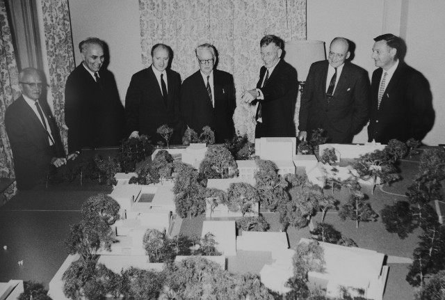 Key figures in the CFA's construction are pictured from far right to left as: John Martin, local architect, chair of the CFA's faculty committee and its first director, and professor of Art; C.B. Stone '23, chairman of the Trustee Buildings and Grounds Committee; Victor L. Butterfield, Wesleyan's 11th president; Howard Matthews, vice-president; Kevin Roche, architect; and Earl Johnson, college engineer.