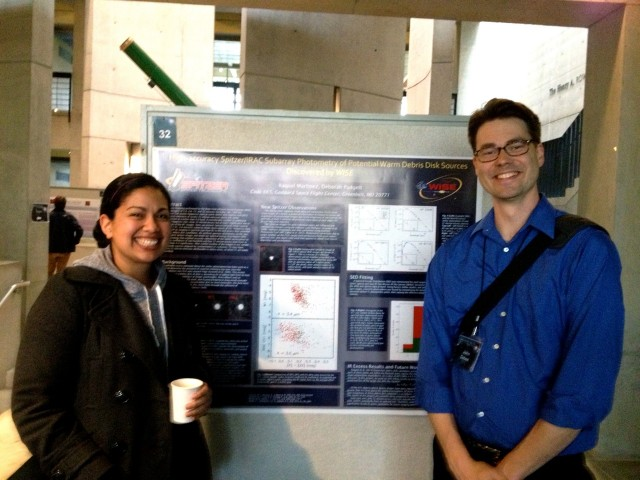 Raquel Martiniz MA '13 poses with her research poster and conference organizer John Debes. Raquel is currently working in NASA's Goddard Spaceflight Center and has been accepted to the Ph.D. program at the University of Texas where she will begin studies in the fall.