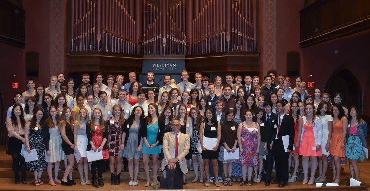 President Michael Roth, pictured in center, honored newly-elected Phi Beta Kappa members in Memorial Chapel on May 24.