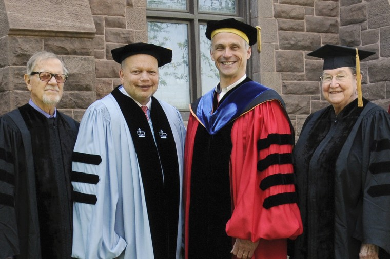 Pictured, from left, are Hayden White, Ted Shaw '76, Wesleyan President Michael Roth and Helena Chmura Kraemer. (Photo by John Van Vlack)