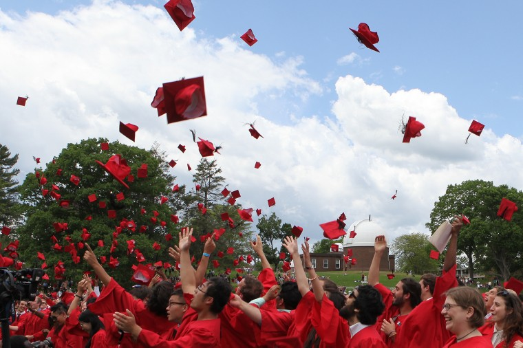 The Class of 2014 celebrates their commencement with a hat toss.