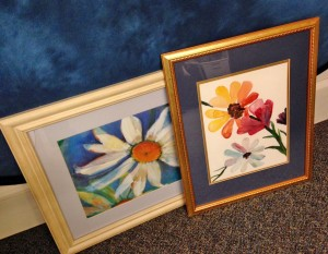 "Lisa Pinette, library assistant in Olin Library, offered this watercolor paintings recently on Wesleyan's Freecycle listserv. ""They've been sitting in my closet for years. One of them is actually my own painting! I'm glad someone finds the beauty in them, and was able to take them and re-use them."""