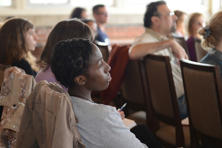 Conference participants enjoy Robinson's lecture.