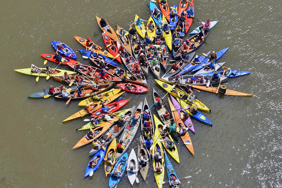 Wesleyan faculty and staff participated in a crowd-generated performance art collaboration on the Connecticut River, June 28.