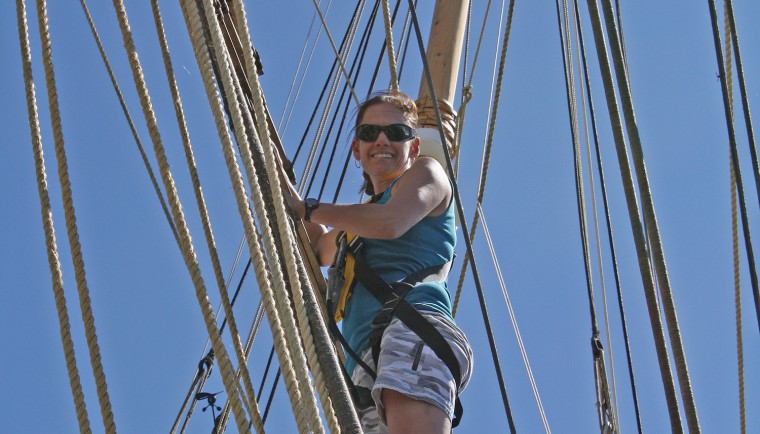 Helen Poulos climbs the rigging aboard the Charles W. Morgan, the last wooden whaling ship in existence.