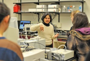Ishita Mukerji, dean of Natural Sciences and Mathematics, professor of molecular biology and biochemistry, leads a lab tour.
