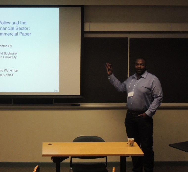 New faculty member Karl Boulware, assistant professor of economics, spoke.
