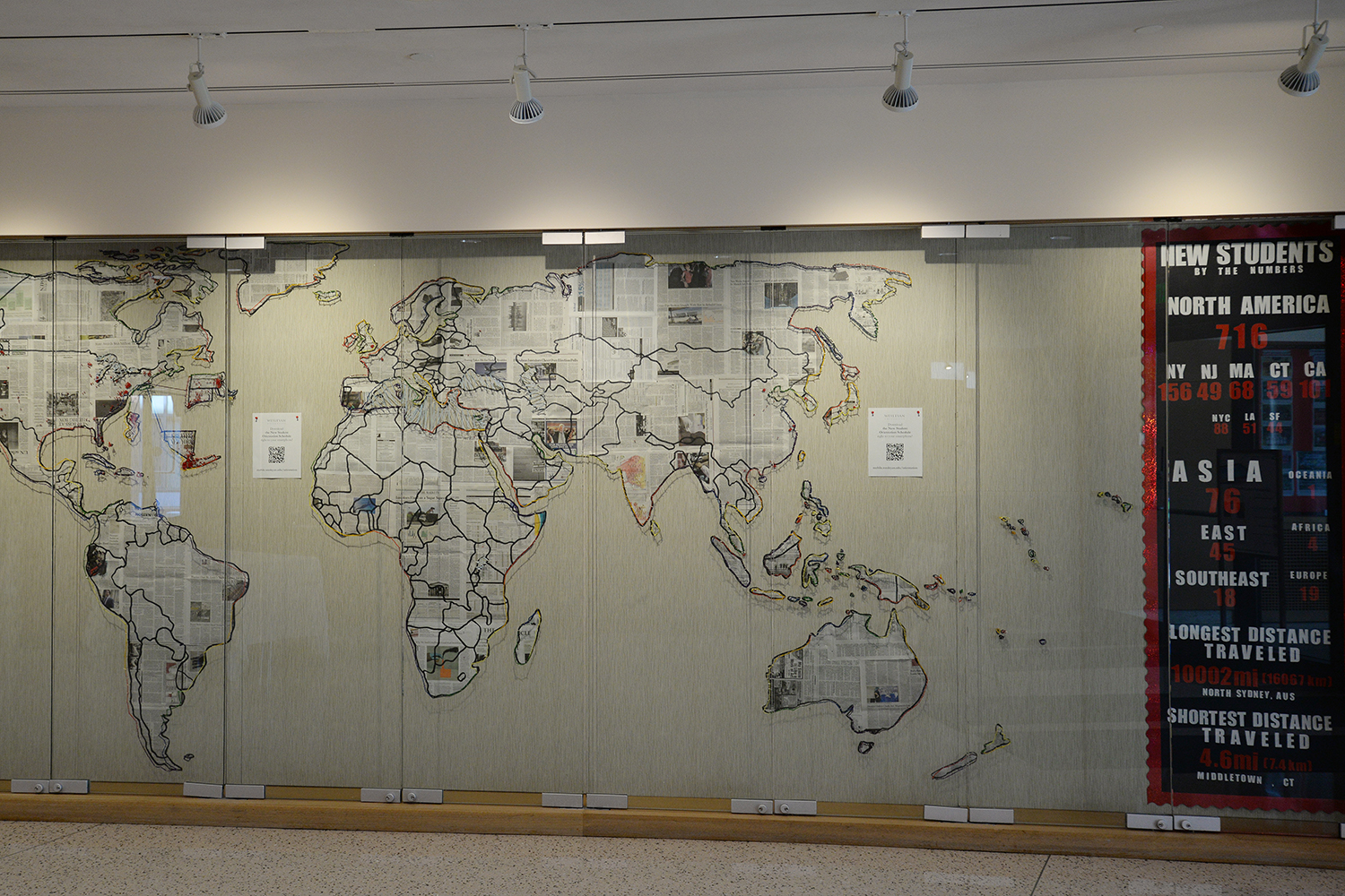 A map in Usdan University Center created out of recycled paper, yarn and pins by student Orientation interns illustrates the geographic diversity of Wesleyan's newest students. The new students—including the Class of 2018, transfer and graduate students—come from as as close as Middletown and as far away as North Sydney, Australia (20,002 miles).