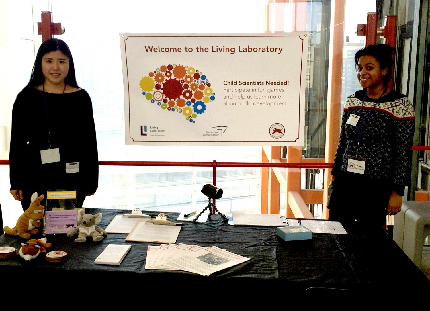 Cognitive Development Lab students Ziyue Li '16 and Portia Lundie '14 spoke with children and parents at the Connecticut Science Center last spring.