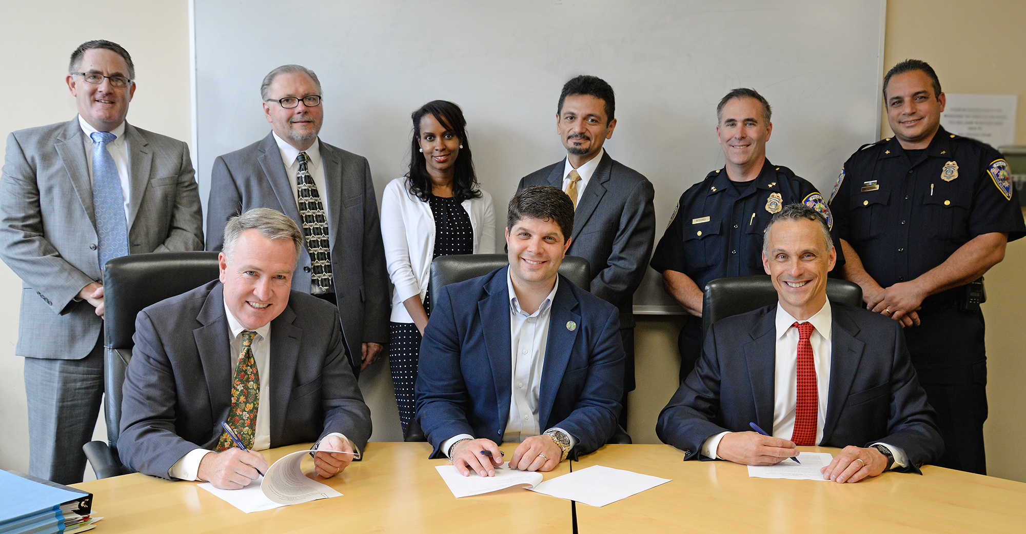 Participants included: Front row, from left, Peter McShane; Mayor Dan Drew and President Michael Roth. Back row, from left, General Counsel and Secretary of the University David Winakor; Director of Public Safety Scott Rodhe; Therapist/Sexual Assault Resource Coordinator Alysha Warren; Vice President for Equity and Inclusion/Title IX Officer Antonio Farias; Middletown Police Chief William McKenna and Middletown Police Deputy Chief Michael Timbro.
