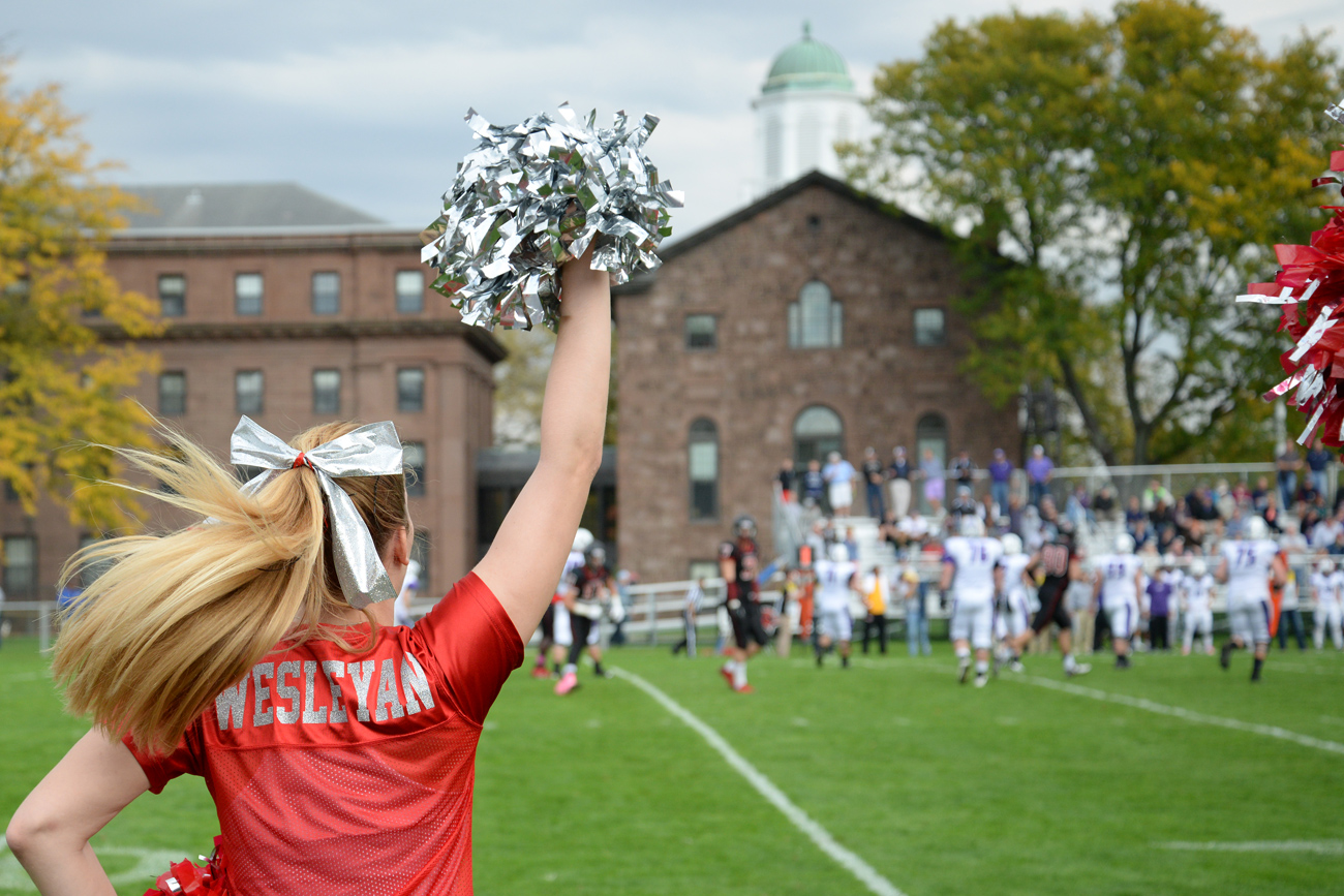 Wesleyan cheerleaders root on the Cardinals during the annual Homecoming football game against Amherst College, Oct. 18. The team fell to its rivals in overtime, 33-30, the team's first loss of the year.