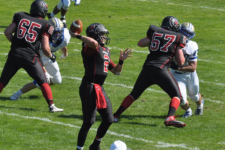 Wesleyan student-athlete Jesse Warren '15 will start as quarterback in the Homecoming Day game, Oct. 18 against Amherst College. Warren leads the conference in passing efficiency (154.9) and has a league-best seven touch down tosses while throwing no interceptions. (Photo by Brian Katten)