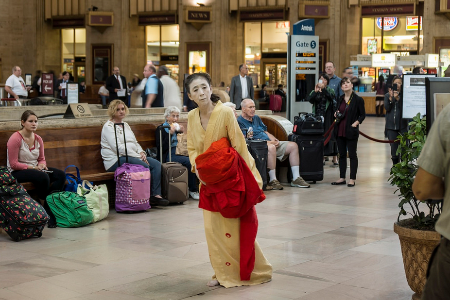 "Eiko Otake, visiting instructor in dance, performed ""Body in a Station"" at the Amtrack's 30th Street Station in Philadelphia on Oct. 8. Otake will speak on ""Nakedness"" Nov. 5 and participate in an exhibition titled ""A Body in Fukushima,"" at Wesleyan starting in February 2015. (Photo by William Johnston)"
