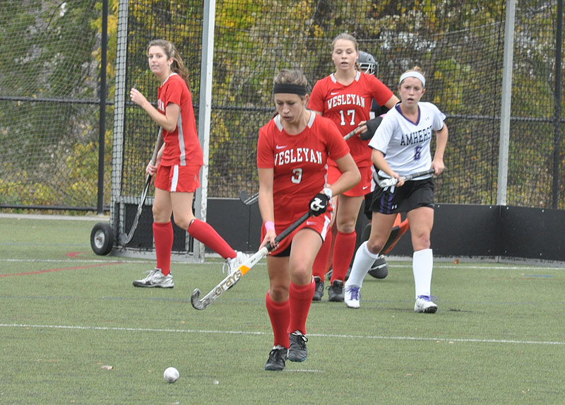 Vanessa Block '15 (#3) controls the ball during field hockey's matchup with Amherst.  Lilah Fones '15 (#17) looks on.Vanessa Block '15 (#3) controls the ball during field hockey's matchup with Amherst.  Lilah Fones '15 (#17) looks on.