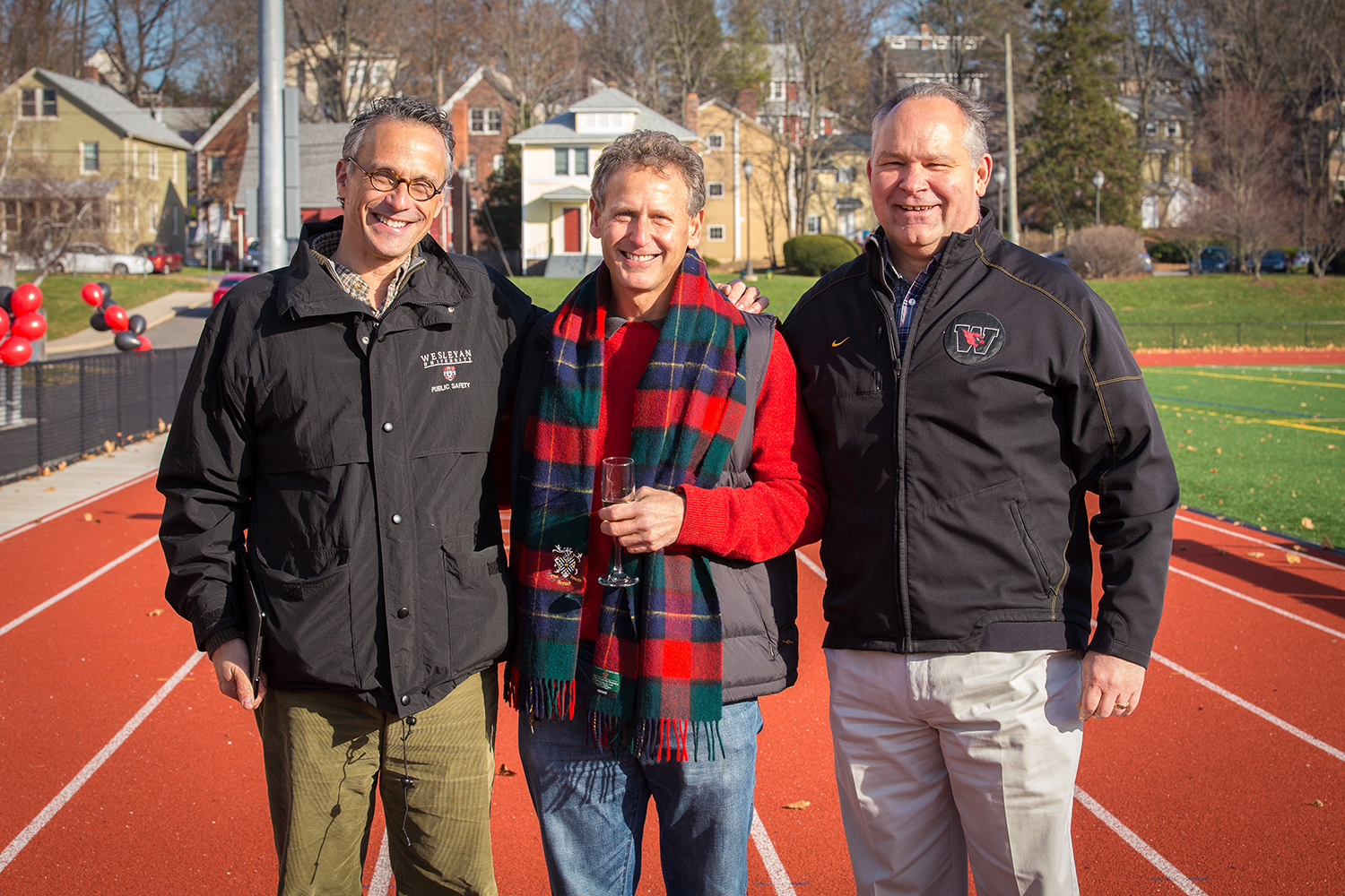 Jim Citrin P'12, P'14, in center, spoke on behalf of the Citrin family with President Michael Roth, at left, and Athletics Director Mike Whalen '83, at right. Jim Citrin's son, Teddy Citrin '12, was a high-scoring, four-year letterman in men's lacrosse, racking up 76 goals and 13 assists for 89 scoring points while helping the Cardinals post a record of 42-23 from 2009-12. His other son, Oliver Citrin '14, was a outstanding fan and men's lacrosse team photographer during his Wesleyan years.