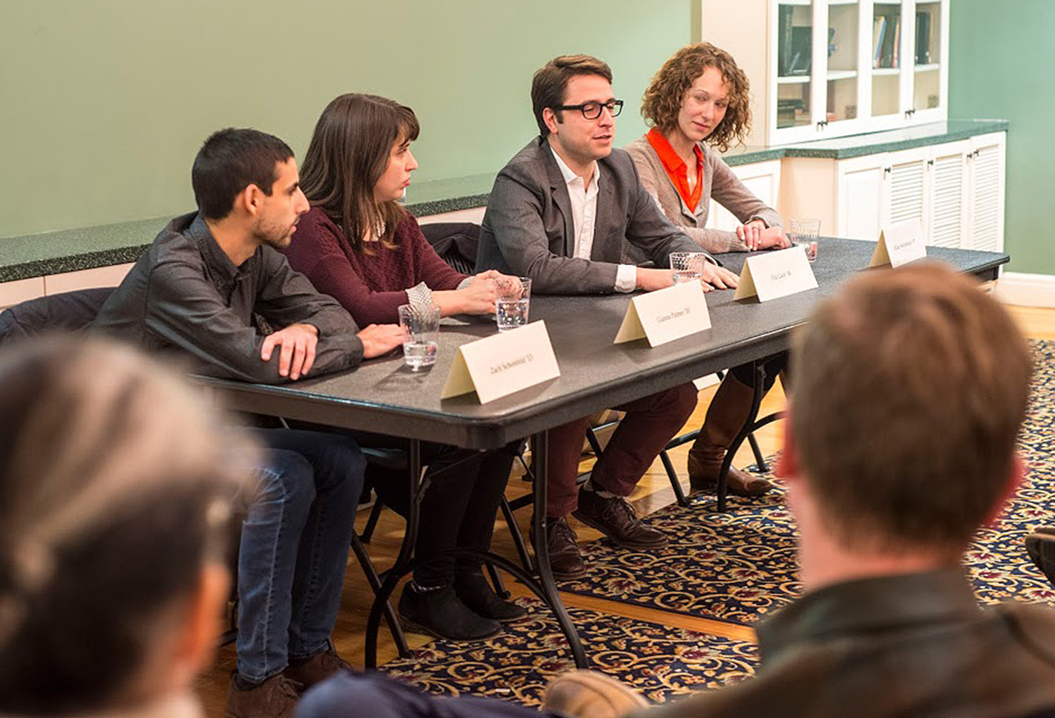 "Four Wesleyan alumni spoke to Wesleyan students about ""Finding a Career Path in New Media Journalism"" Nov. 18 in Downey House. Panelists included, from left, Zach Schonfeld '13, Gianna Palmer '10, Eric Lach '08 and Jillian Weinberger '07."