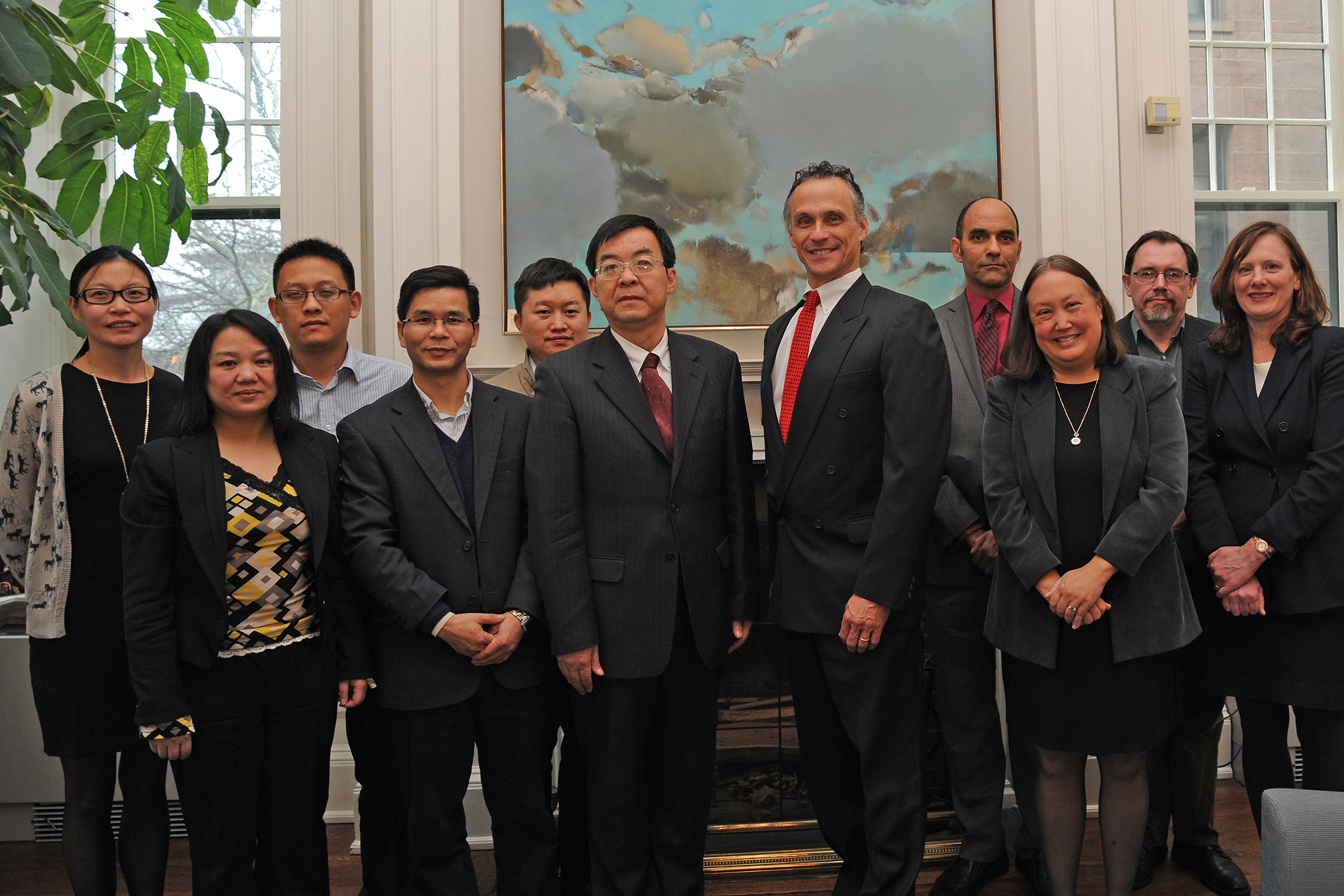 Scholars from Wesleyan and the Social Sciences in China Press gathered Dec. 10 to sign a memorandum of understanding. Pictured are, front row from left, Daimei Feng, Changbao Wei, Limin Wang, Michael Roth, Joyce Jacobsen, and Jennifer Tucker. Back row, from left, Guofei Chu, Bing Jiao, Qun Zhou, Gary Shaw, and Peter Rutland.