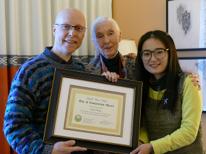 Professor of Psychology Scott Plous and anthropologist Jane Goodall presented Qian Zhang of China with a Day of Compassion Award from the Jane Goodall Institute. Zhang was a student in Plous's Social Psychology MOOC last summer and received the honor for intervening when she heard a boy being beaten in a neighboring apartment.