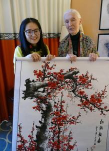 Award recipient Qian Zhang presented Dr. Goodall with a scroll painting from Chengdu, China.