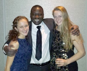 Ella Israeli '17, Kennedy Odede '12 and Kiley Kennedy '16 shared a group hug at the Ripple of Hope Gala.