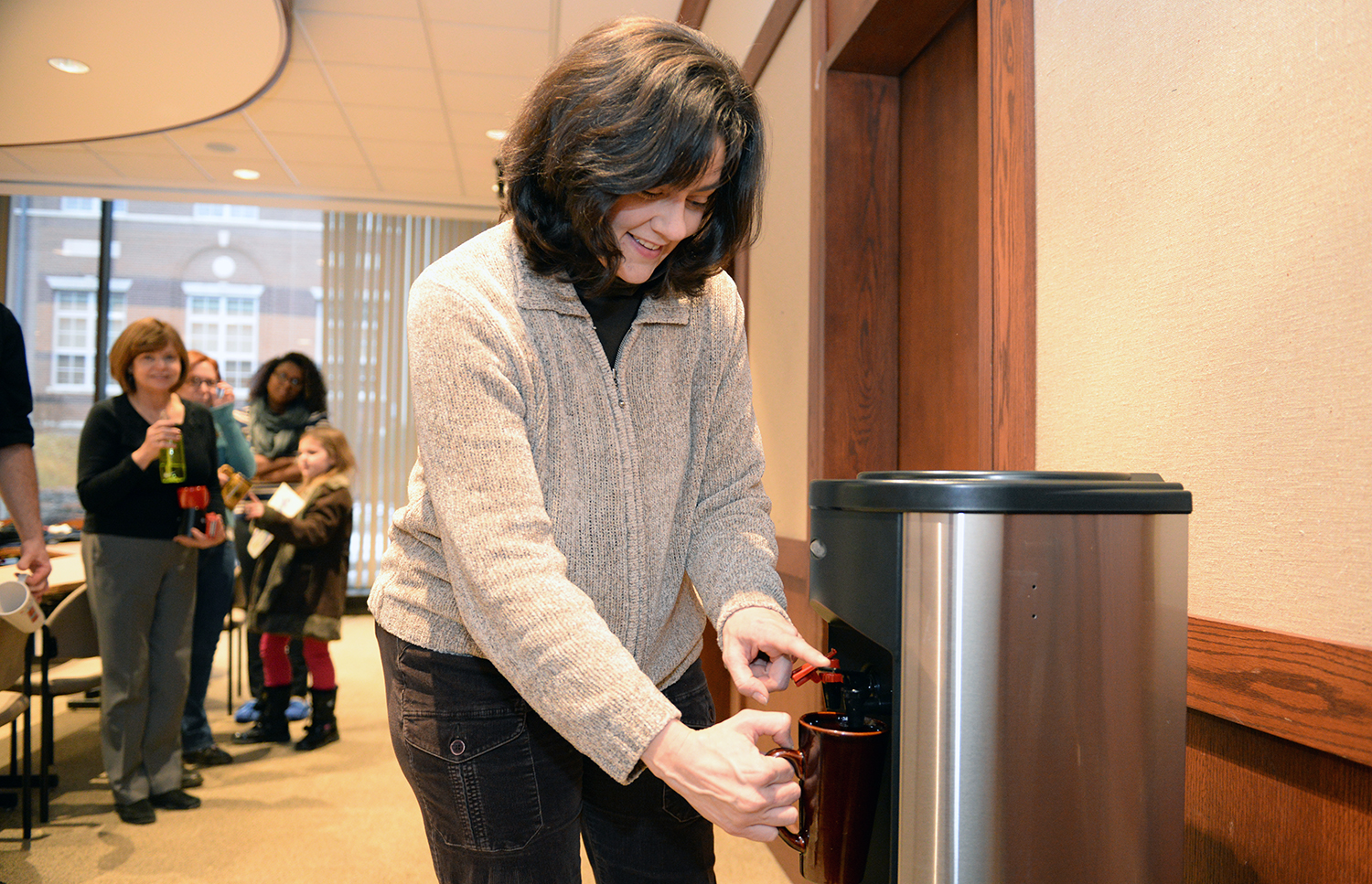 Dawn Alger, administrative assistant in the Theater Department, uses the new water filter. The system has an on/off switch in the rear to help save electricity when not in use.
