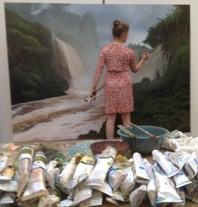 Tula Telfair works on one of her oil paintings.
