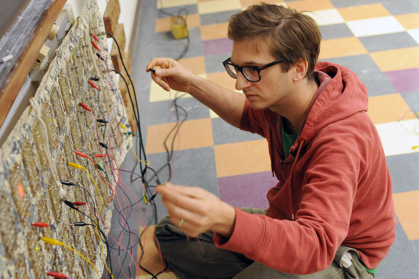 Graduate student Peter Blasser tunes one of his hand-crafted analog instruments. (Photos by Olivia Drake)