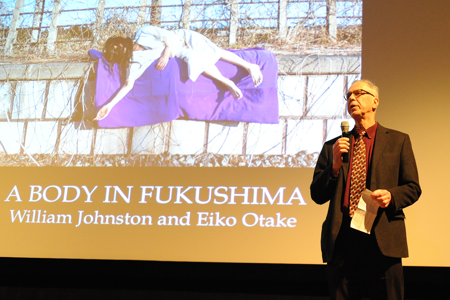 Patrick Dowdey, curator for the Freeman Center for East Asian Studies gallery, introduced the <em>Body in Fukushima</em> exhibit Feb. 5.