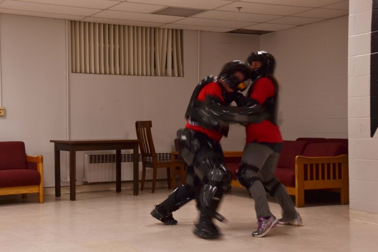 Lt. Jay Mantie, in the RAD protective suit, attacks Officer Kathy Burdick.