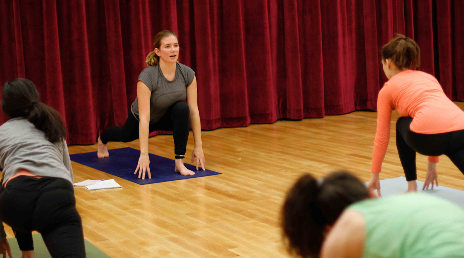 Katie McLaughlin '15 teaches a WesBAM! class called Vinyasa Flow Fusion, which combines meditation, breathing techniques and traditional asana practice for whole body health and happiness.