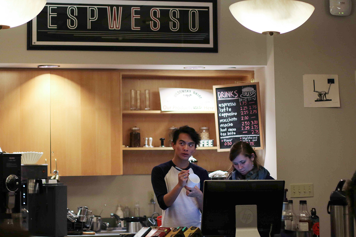 Emily Pfoutz '16 and Rick Manayan '17 busily make and distribute drinks at Espwesso, Wesleyan's student run cafe.