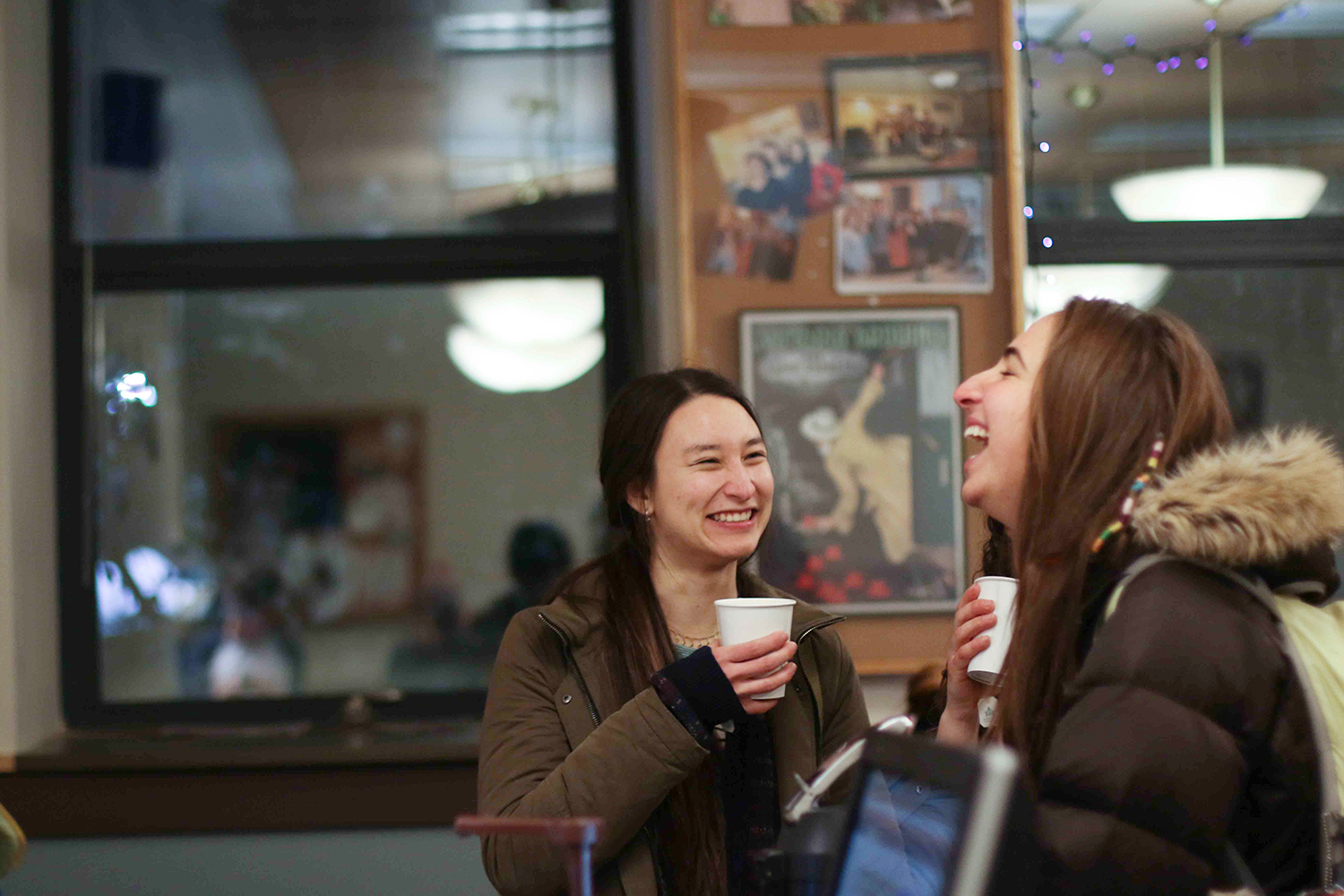 Naomi Saito '16 and Lauren Langer '16 enjoy their drinks.