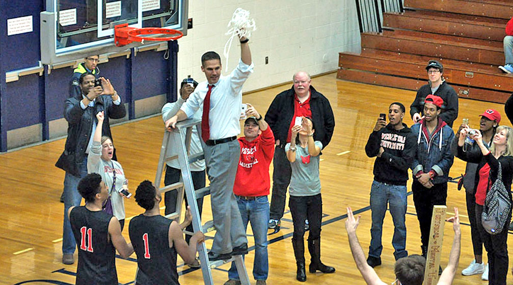 Coach Joe Reilly takes the net after the Cardinals won the NESCAC championship by defeating Amherst on March 1 at Trinity.