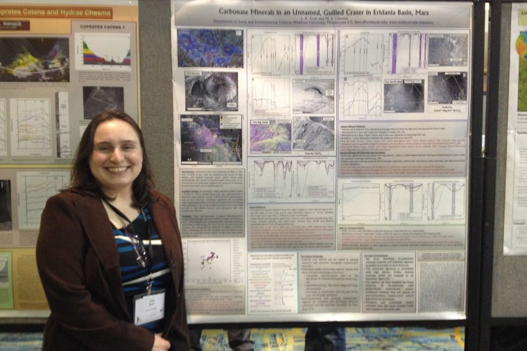 "Lisa Korn, MA '15 presented a poster titled ""Possible Carbonate Minerals within an Unnamed Gulled Crater in Eridania Basin, Mars.""  She was supported by NASA Connecticut Space Grant and the E&ES Foye Fund. Scott Murchie, the Principal Investigator of the instrument whose data she uses (the CRISM spectrometer in orbit at Mars) showed her work to NASA as an example of the important new discoveries being made with the instrument. Korn's advisor is Marty Gilmore, chair and professor of earth and environmental sciences and the George I. Seney Professor of Geology."
