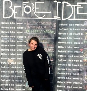 "Laura McIntyre '17 with the ""Before I Die"" cube. (Contributed photo.)"