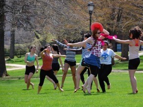 Sarah Greizer '16 and other members of dance class dance in front of College Row.