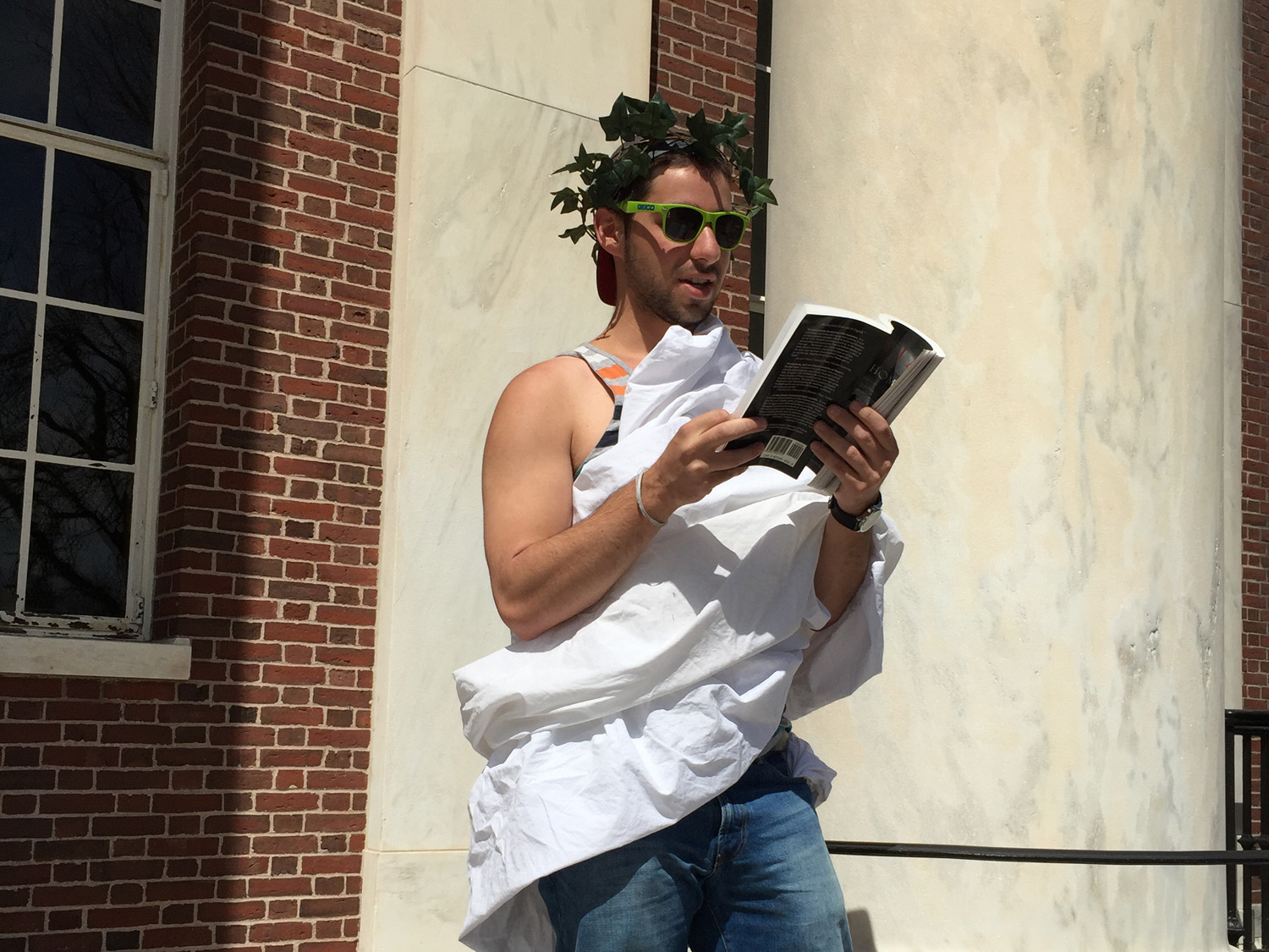 "Emerson Obus '16 reads from Homer's ""Odyssey"" outside Olin Memorial Library on April 16 as part of the annual day-long Homerathon sponsored by the Department of Classical Studies."