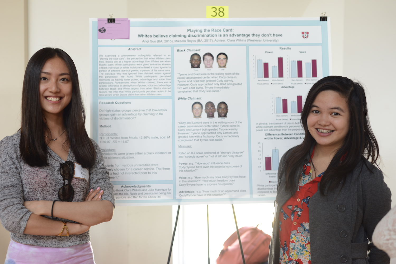 "Anqi Guo '15 and Mikaela Reyes '17 with their research on ""Playing the Race Card."""