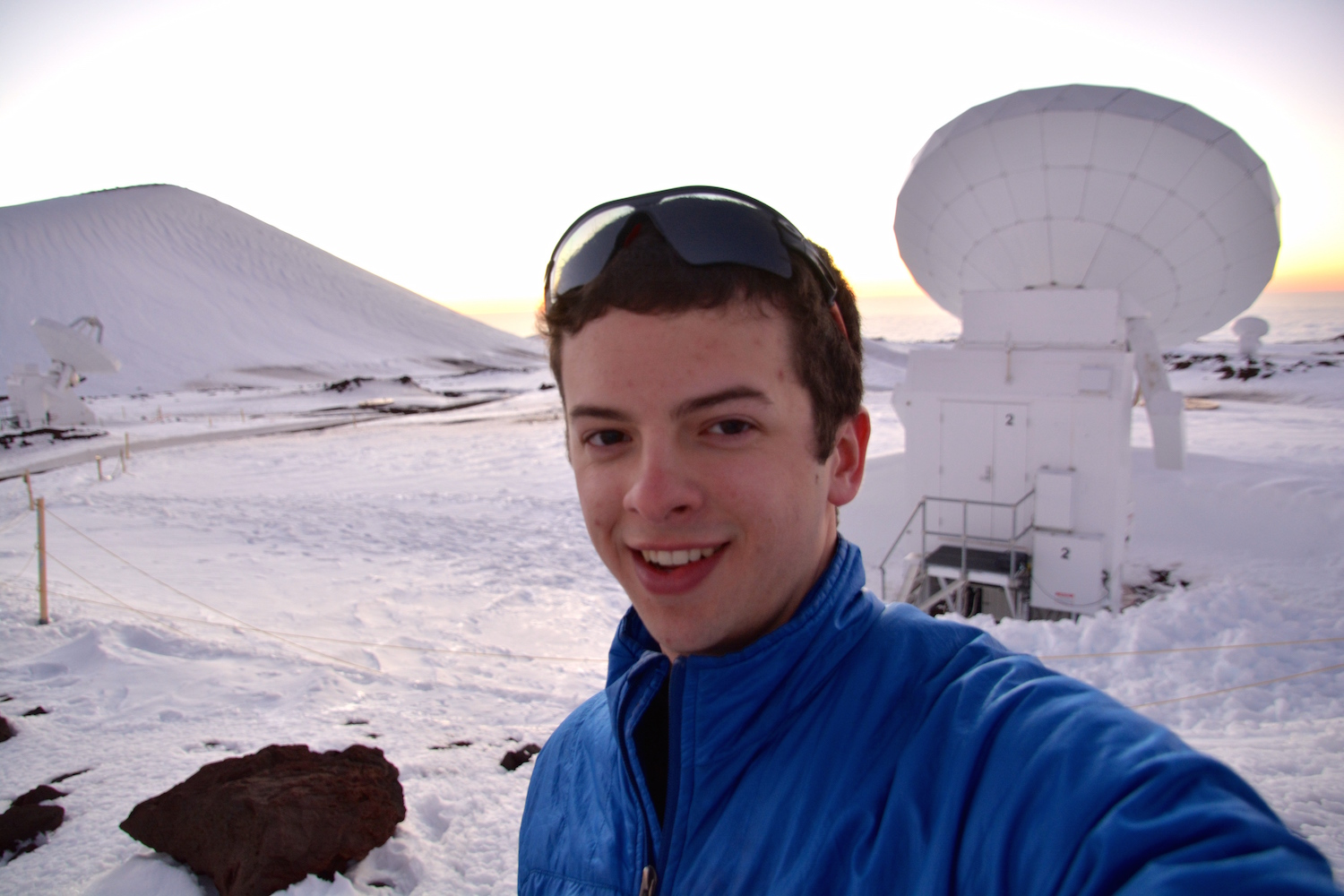 Sam Factor, a graduate student in astronomy, at the Submillimeter Array, located on Mauna Kea in Hawai'i in March 2015.