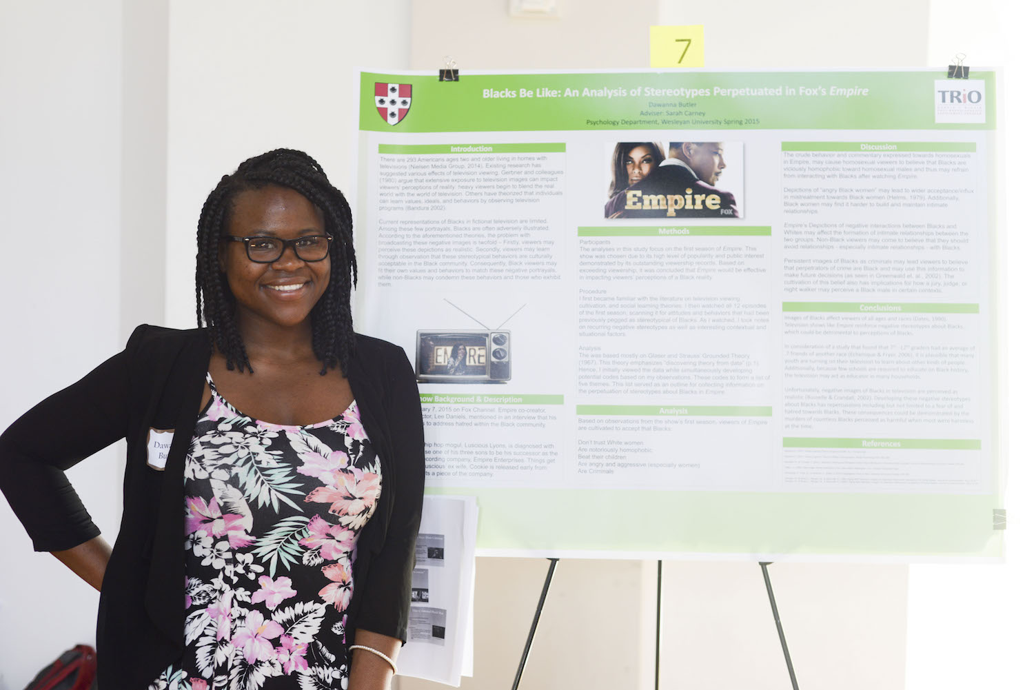 "Dawanna Butler '15 with her poster, ""Blacks Be Like: An Analysis of Stereotypes Perpetuated in Fox's Empire."""