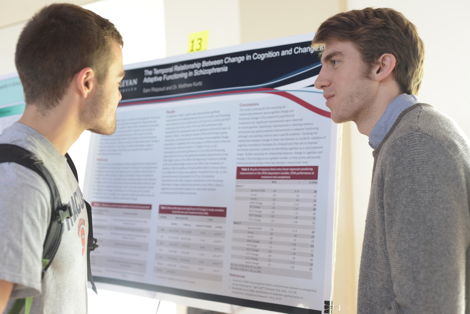 "Sam Rispaud '15, right, discusses his research, ""The temporal relationship between change in cognition and change in adaptive functioning in schizophrenia,"" with Patrick Masi-Phelps '15."